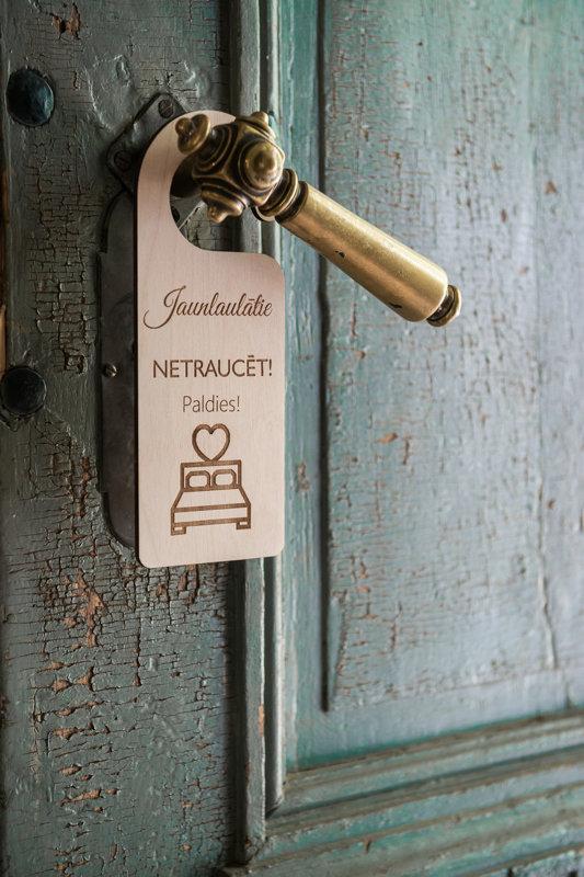 Durvju zīme - jaunlaulāto numuram